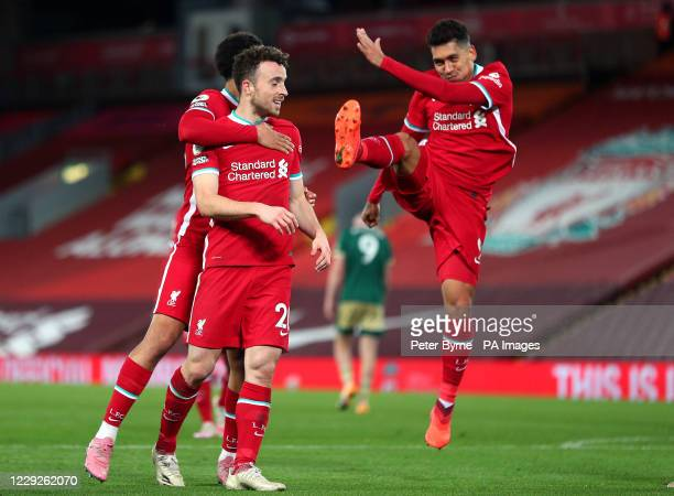 Liverpool's Diogo Jota celebrates scoring his side's second goal of the game with Trent Alexander-Arnold and Roberto Firmino during the Premier...
