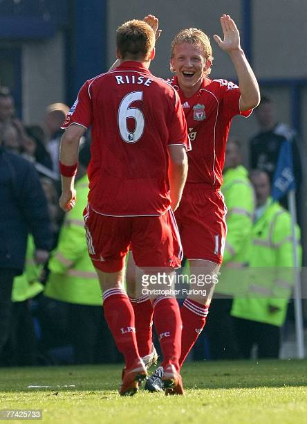Liverpool's Dirk Kuyt celebrates scoring his penalty with team mate John Arne Riise during the Barclays Premiership match between Everton and...