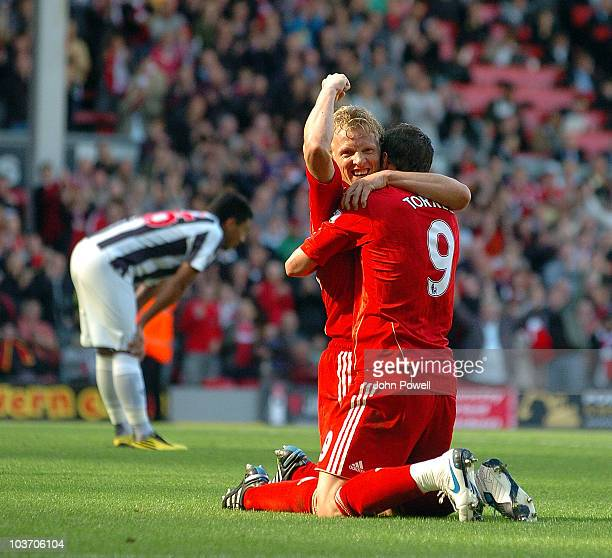 Liverpool's Dirk Kuyt congratulates Fernando Torres of Liverpool after his goal as Gonzalo Jara looks dejected during the Barclays Premier League...
