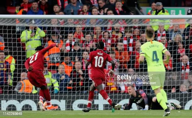 LIVERPOOL ENGLAND MAY Liverpool's Divock Origi scores the opening goal during the UEFA Champions League Semi Final second leg match between Liverpool...