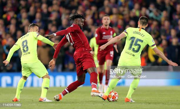 Liverpool's Divock Origi vies for possession with Barcelona's Clement Lenglet during the UEFA Champions League Semi Final second leg match between...