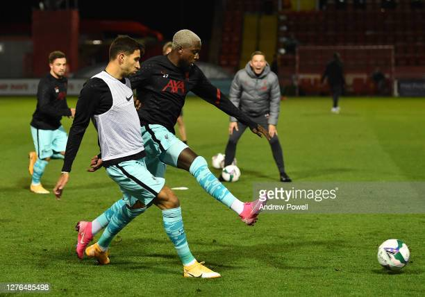 Liverpool's Divock Origi with Liverpool's Marko Grujic before the Carabao Cup third round match between Lincoln City and Liverpool at Sincil Bank...