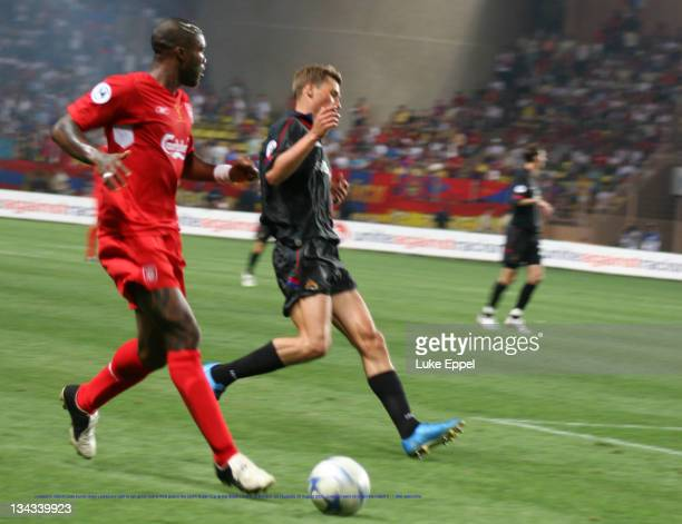 Liverpool's Djibrill Cisse bursts down Liverpool's right to set up his teams third goal in the UEFA Super Cup at the Stade Louis II, in Monaco, on...