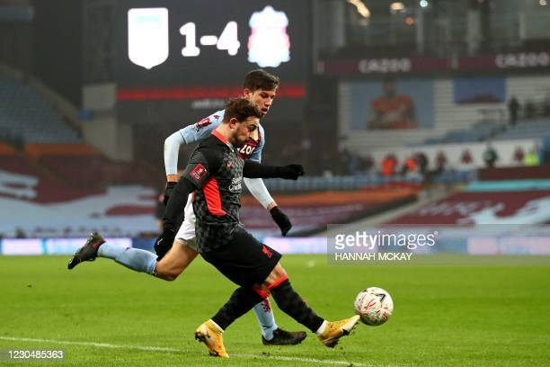 Liverpool's Dutch defender Sepp van den Berg vies with Liverpool's Swiss midfielder Xherdan Shaqiri during the English FA Cup third round football...