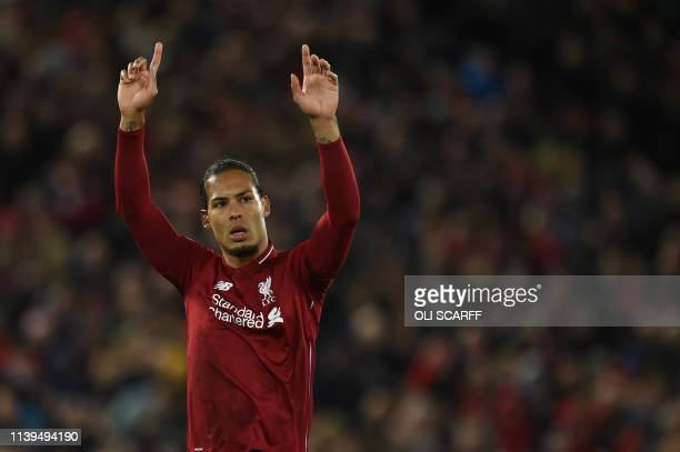 Liverpool's Dutch defender Virgil van Dijk acknowledges supporters during the English Premier League football match between Liverpool and...