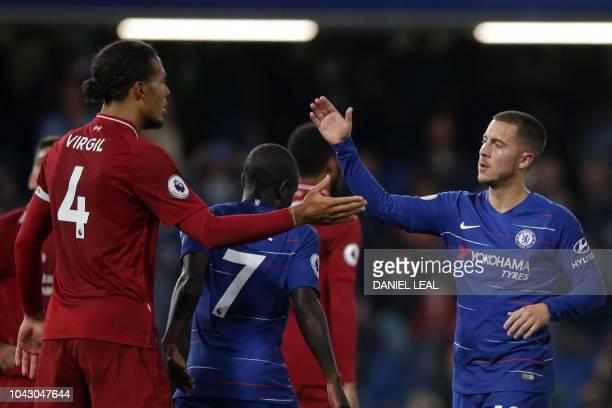 Liverpool's Dutch defender Virgil van Dijk and Chelsea's Belgian midfielder Eden Hazard shake hands after the English Premier League football match...
