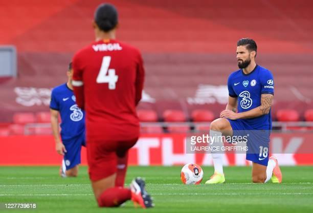 Liverpool's Dutch defender Virgil van Dijk and Chelsea's French striker Olivier Giroud 'take a knee' in support of the Black Lives Matter movement...