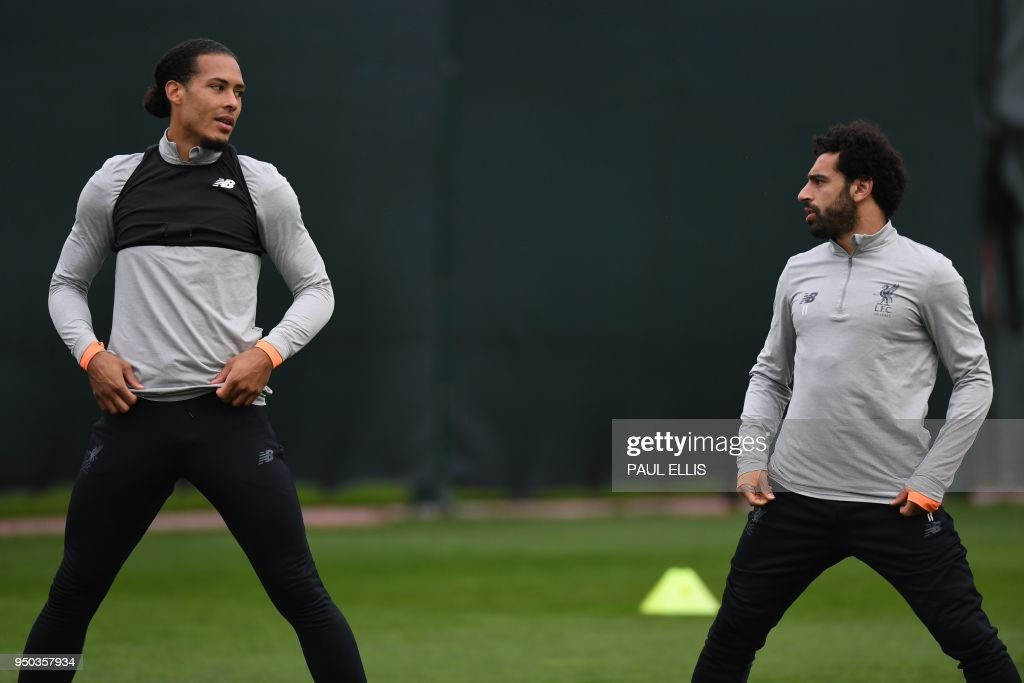 Liverpool's Dutch defender Virgil van Dijk (L) and Liverpool's Egyptian midfielder Mohamed Salah attends a training session at the team's Melwood training complex in Liverpool, north west England, on April 23, 2018 on the eve of their first-leg UEFA Champions League semi-final football match against Roma.