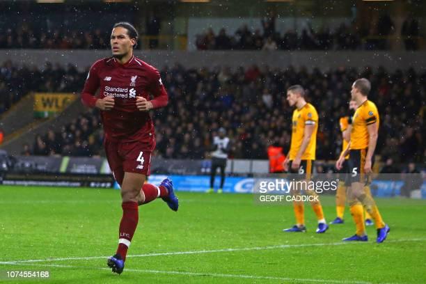 Liverpool's Dutch defender Virgil van Dijk celebrates after scoring their second goal during the English Premier League football match between...