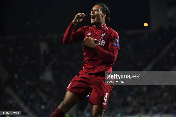 Liverpool's Dutch defender Virgil van Dijk celebrates after scoring his team's fourth goal during the UEFA Champions League quarterfinal second leg...