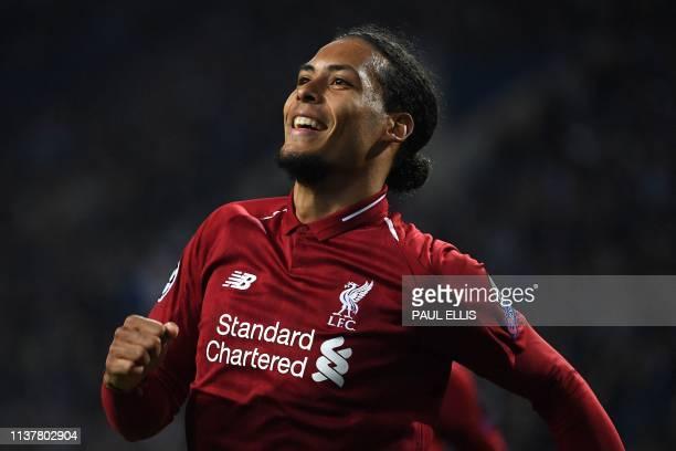 Liverpool's Dutch defender Virgil van Dijk celebrates after scoring his team's fourth goal during the UEFA Champions League quarterfinal second leg...
