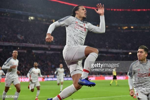 Liverpool's Dutch defender Virgil van Dijk celebrates scoring the 12 goal with his teammates during the UEFA Champions League last 16 second leg...