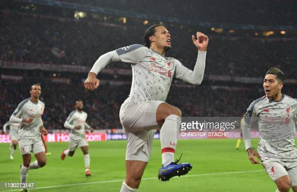 Liverpool's Dutch defender Virgil van Dijk celebrates scoring the 12 goal with his teammate Brazilian midfielder Roberto Firmino during the UEFA...
