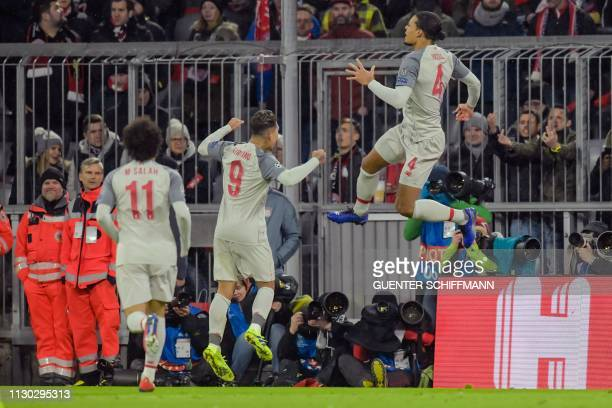 Liverpool's Dutch defender Virgil van Dijk celebrates scoring the 12 goal with his teammates during the UEFA Champions League last 16 second leg...