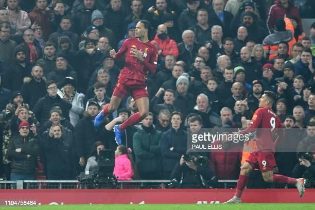 TOPSHOT Liverpool's Dutch defender Virgil van Dijk celebrates scoring the opening goal during the English Premier League football match between...