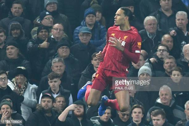 Liverpool's Dutch defender Virgil van Dijk celebrates scoring the opening goal during the English Premier League football match between Liverpool and...