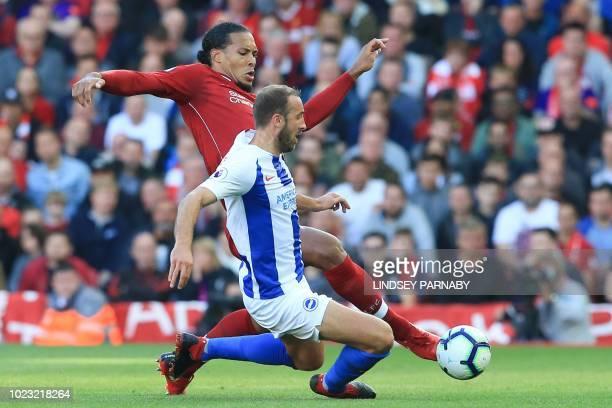 Liverpool's Dutch defender Virgil van Dijk challenges Brighton's English striker Glenn Murray during the English Premier League football match...