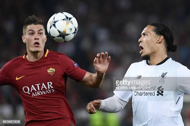 Liverpool's Dutch defender Virgil van Dijk challenges Roma's Czech striker Patrik Schick during the UEFA Champions League semifinal second leg...