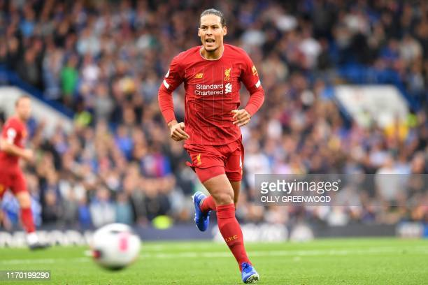 Liverpool's Dutch defender Virgil van Dijk chases the ball during the English Premier League football match between Arsenal and Aston Villa at the...