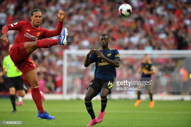 Liverpool's Dutch defender Virgil van Dijk clears the ball during the English Premier League football match between Liverpool and Arsenal at Anfield...