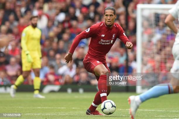 Liverpool's Dutch defender Virgil van Dijk controls the ball during the English Premier League football match between Liverpool and West Ham United...