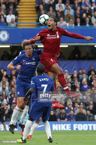 Liverpool's Dutch defender Virgil van Dijk heads the ball during the English Premier League football match between Chelsea and Liverpool at Stamford...