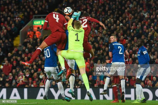Liverpool's Dutch defender Virgil van Dijk heads the ball to score their second goal during the English FA Cup third round football match between...