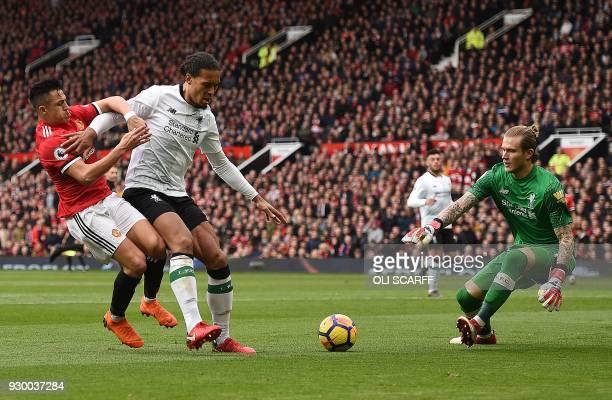 Liverpool's Dutch defender Virgil van Dijk holds off Manchester United's Chilean striker Alexis Sanchez in front of Liverpool's German goalkeeper...
