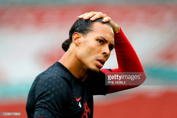 Liverpool's Dutch defender Virgil van Dijk looks on ahead of the English Premier League football match between Liverpool and Leeds United at Anfield...