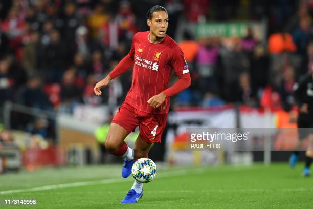Liverpool's Dutch defender Virgil van Dijk looks to pass the ball during the UEFA Champions league Group E football match between Liverpool and...