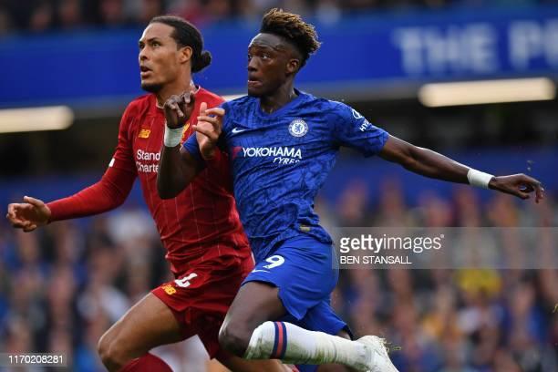 Liverpool's Dutch defender Virgil van Dijk marks Chelsea's English striker Tammy Abraham during the English Premier League football match between...