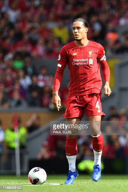 Liverpool's Dutch defender Virgil van Dijk on the ball during the English Premier League football match between Liverpool and Newcastle at Anfield in...