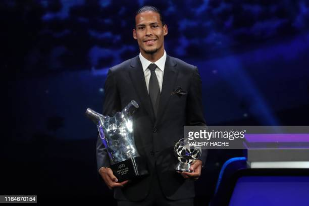 Liverpool's Dutch defender Virgil van Dijk poses with his trophies of Best Men's player in Europe of the Year and Best Defender at the end of the...