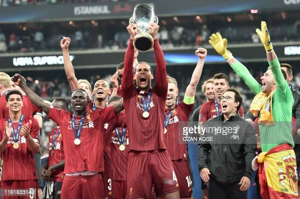 Liverpool's Dutch defender Virgil van Dijk poses with the trophy after winning the UEFA Super Cup 2019 football match between FC Liverpool and FC...