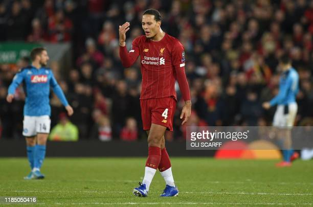 Liverpool's Dutch defender Virgil van Dijk reacts during the UEFA Champions league Group E football match between Liverpool and Napoli at Anfield in...