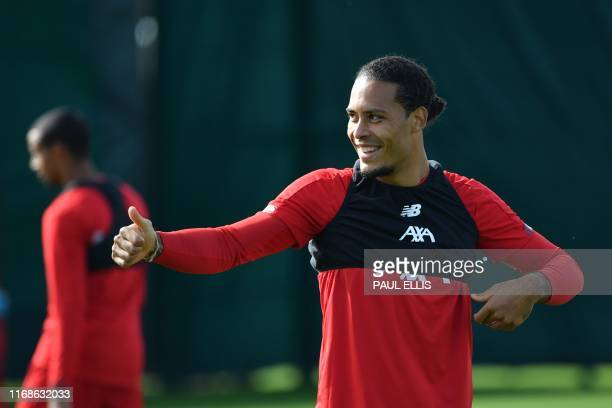 Liverpool's Dutch defender Virgil van Dijk takes part in a training session at their Melwood complex Liverpoolnorth west England n the eve of their...