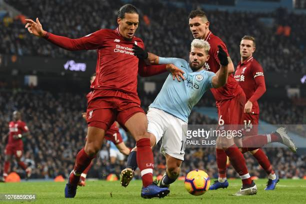 Liverpool's Dutch defender Virgil van Dijk vies with Manchester City's Argentinian striker Sergio Aguero during the English Premier League football...