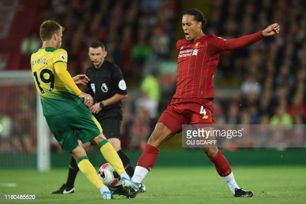 Liverpool's Dutch defender Virgil van Dijk vies with Norwich City's German midfielder Tom Trybull during the English Premier League football match...