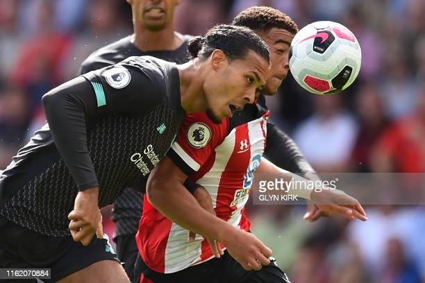 Liverpool's Dutch defender Virgil van Dijk vies with Southampton's English midfielder Che Adams during the English Premier League football match...