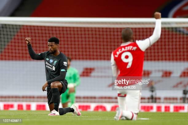 Liverpool's Dutch midfielder Georginio Wijnaldum ans Arsenal's French striker Alexandre Lacazette 'take a knee' in support of the Black Lives Matter...