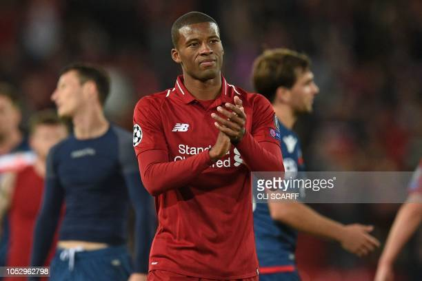 Liverpool's Dutch midfielder Georginio Wijnaldum applauds supporters on the pitch after the UEFA Champions League group C football match between...