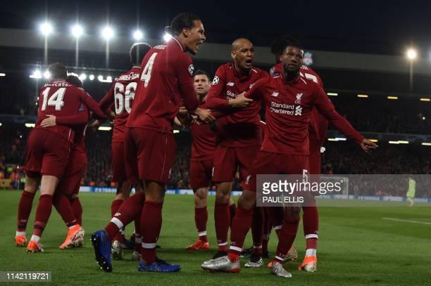 Liverpool's Dutch midfielder Georginio Wijnaldum celebrates after scoring their third goal during the UEFA Champions league semifinal second leg...