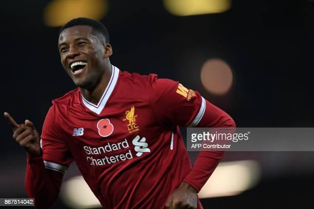 Liverpool's Dutch midfielder Georginio Wijnaldum celebrates after scoring their third goal during the English Premier League football match between...