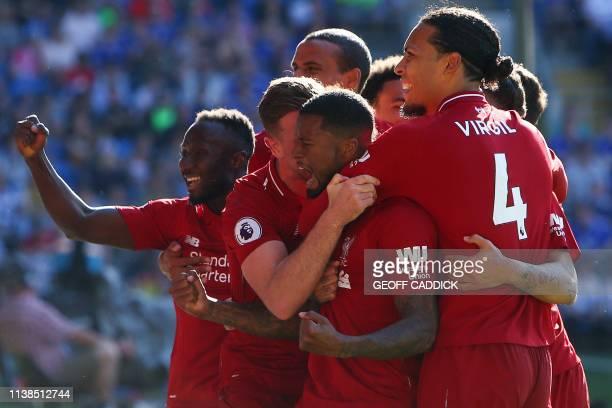 Liverpool's Dutch midfielder Georginio Wijnaldum celebrates scoring the opening goal during the English Premier League football match between between...
