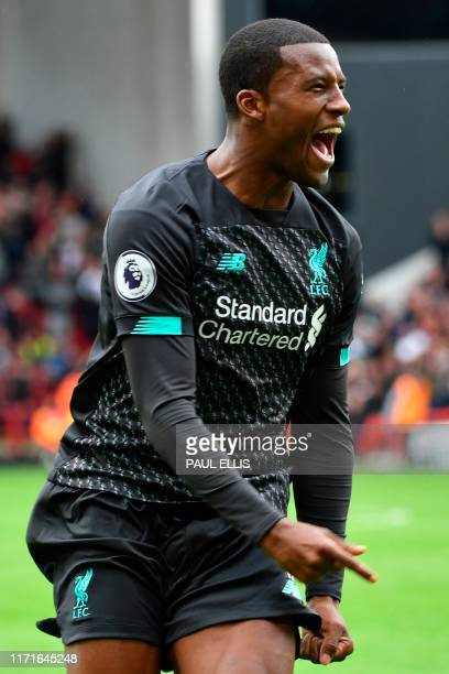 Liverpool's Dutch midfielder Georginio Wijnaldum celebrates scoring the opening goal during the English Premier League football match between...