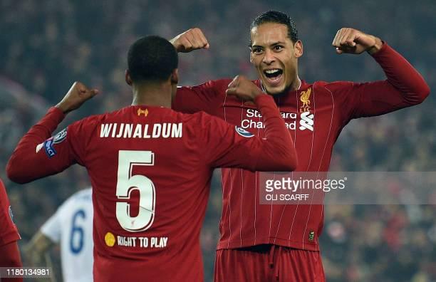 Liverpool's Dutch midfielder Georginio Wijnaldum celebrates scoring with Liverpool's Dutch defender Virgil van Dijk during the UEFA Champions League...