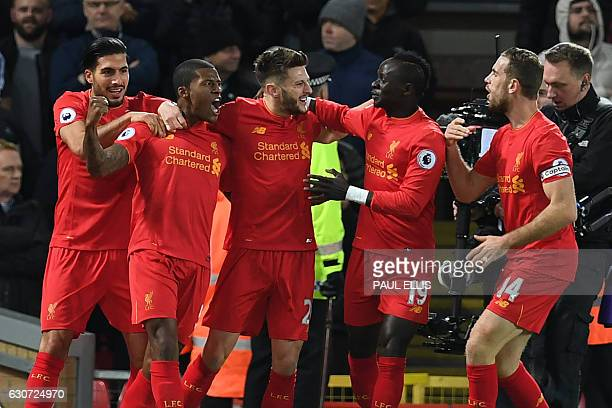Liverpool's Dutch midfielder Georginio Wijnaldum celebrates with teammates after scoring the opening goal of the English Premier League football...