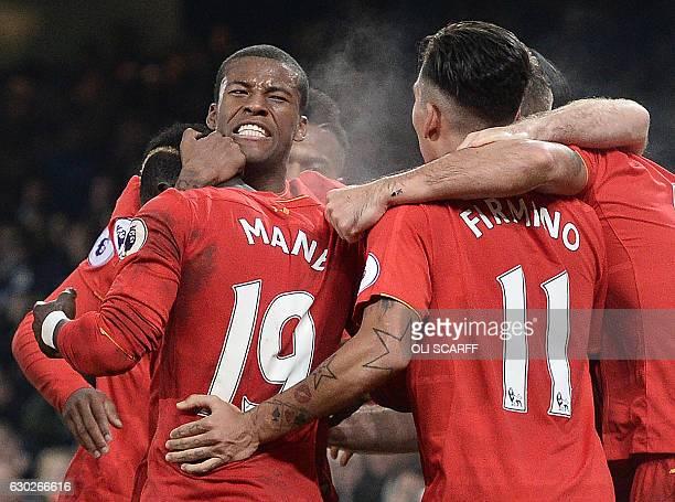 Liverpool's Dutch midfielder Georginio Wijnaldum congratulates Liverpool's Senegalese midfielder Sadio Mane after he scored the first goal during the...