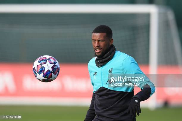 Liverpool's Dutch midfielder Georginio Wijnaldum controls the ball during a training session at Melwood in Liverpool north west England on February...