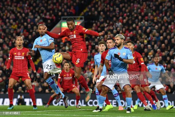 Liverpool's Dutch midfielder Georginio Wijnaldum controls the ball during the English Premier League football match between Liverpool and Manchester...